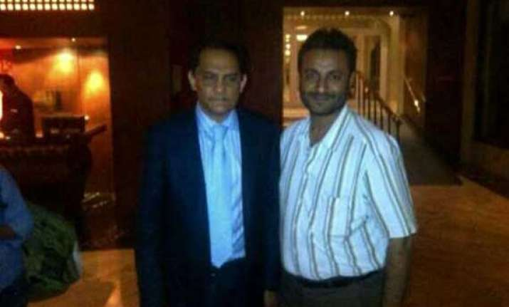 bjp releases pix of hawala accused afroz fatta with md