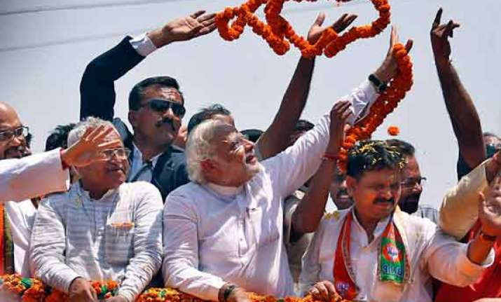 bjp showdown with ec over modi rally in varanasi