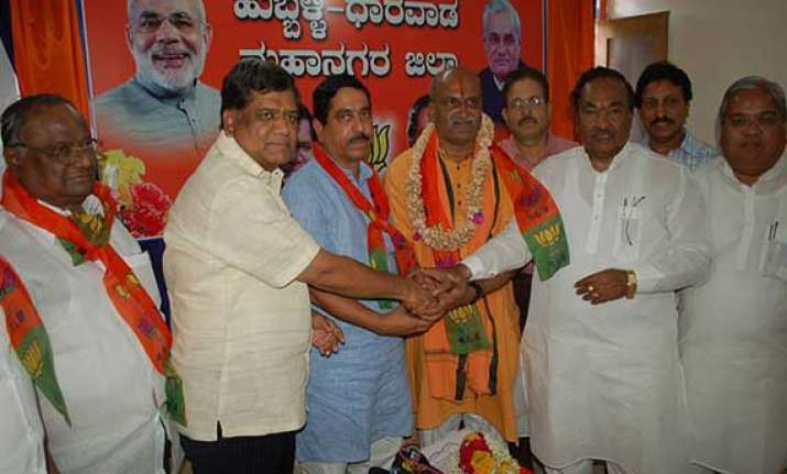 bjp sets aside entry of sri ram sene chief pramod muthalik