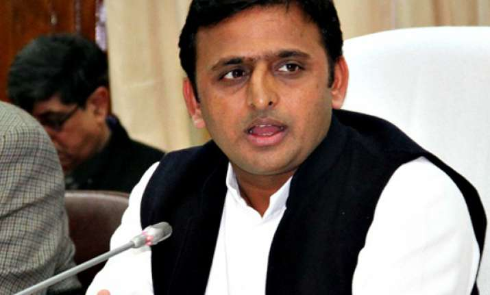 bjp slams akhilesh for banning procession