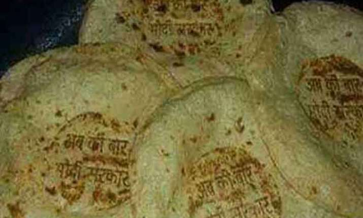 bjp supporters imprint namo mark on rotis laddoos