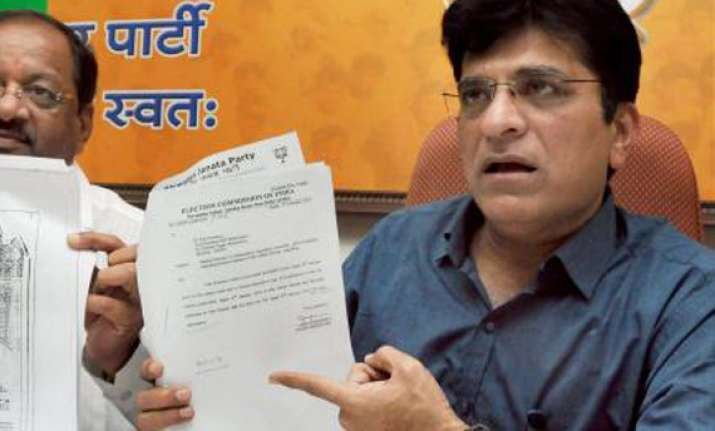 bjp accuses maya of swindling funds with upa s connivance