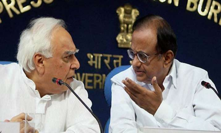 bjp slams pm for not removing chidambaram sibal