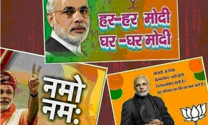 black paint smeared on modi posters in varanasi