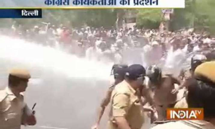 congress cpi m took to streets protesting against rail fare