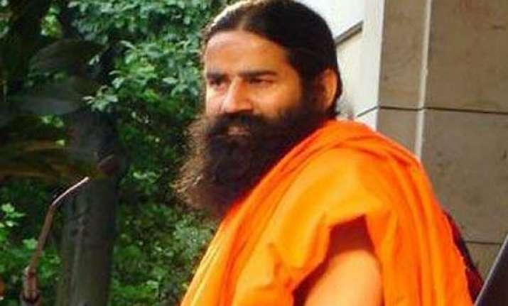 congress gandhi family looting india says swami ramdev