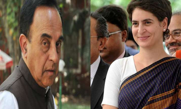 congress demands action against swamy for comments on