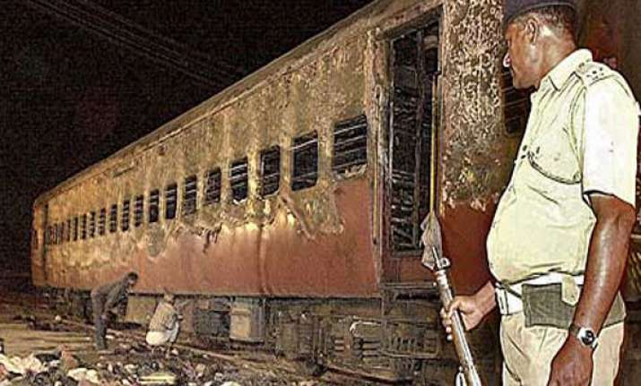 deeply divided godhra braces for poll