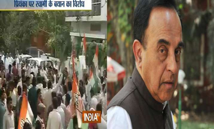 delhi congress protests outside subramanian swamy s
