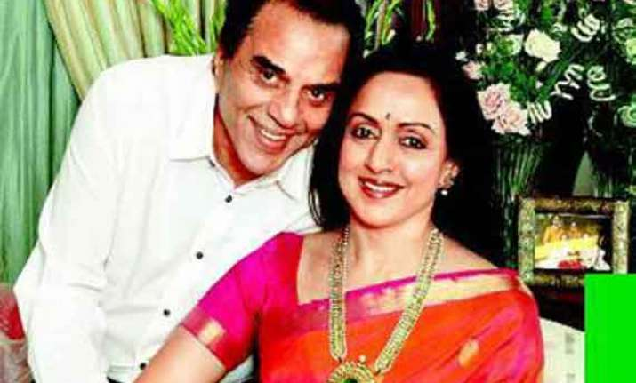 dharmendra s absence questioned as hema s campaign picks up