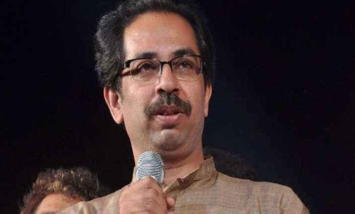 don t poke nose into politics uddhav tells amartya sen
