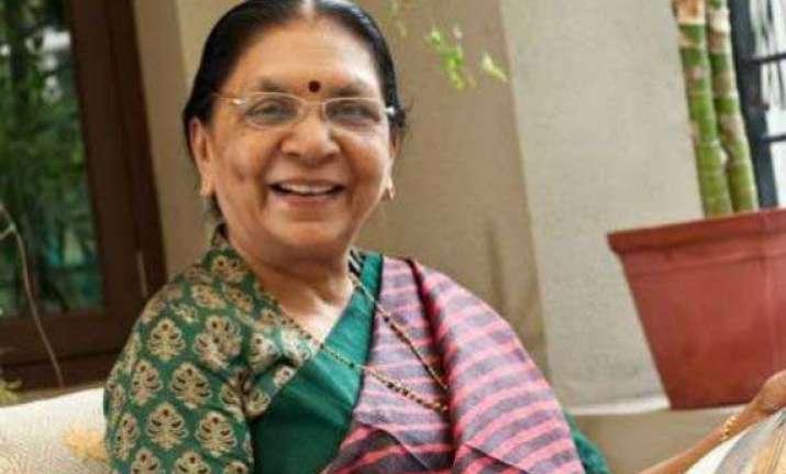 gujarat cm calls on rss chief bhagwat