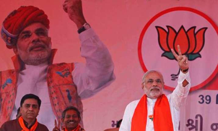 gujarat poll modi sticks to development agenda