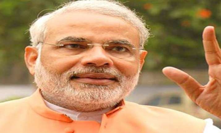 gujarat polls modi dares sonia to name cong cm candidate
