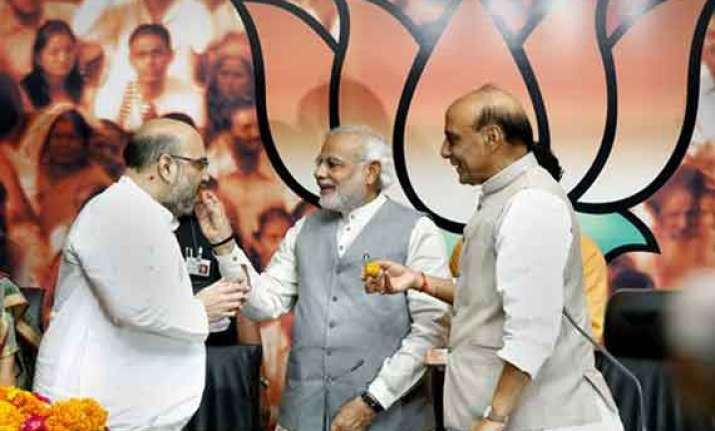 in pics amit shah takes over as bjp president