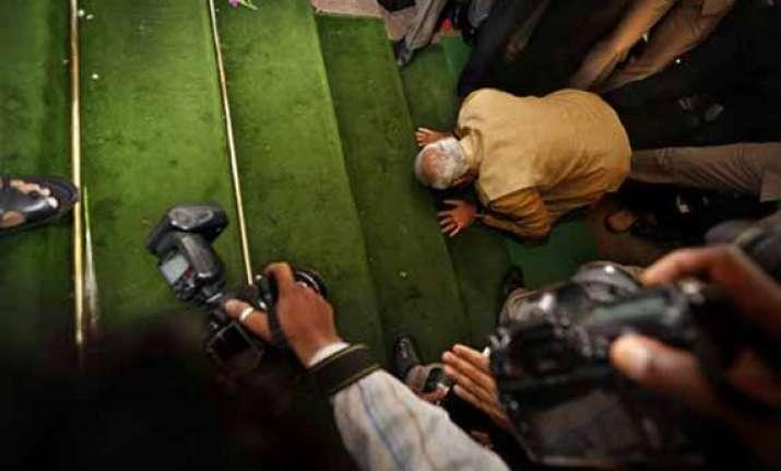 in pics narendra modi bows on parliament steps