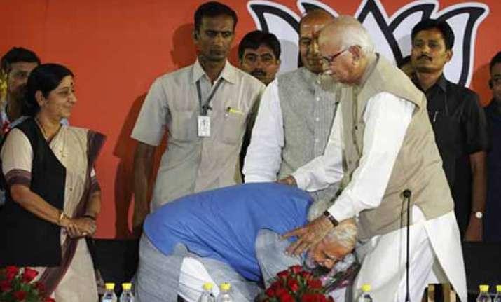in pics when narendra modi touched advani s feet