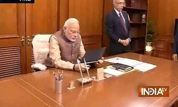 in pics narendra modi takes charge as pm