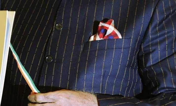 latest updates auction of pm narendra modi s pinstripe suit