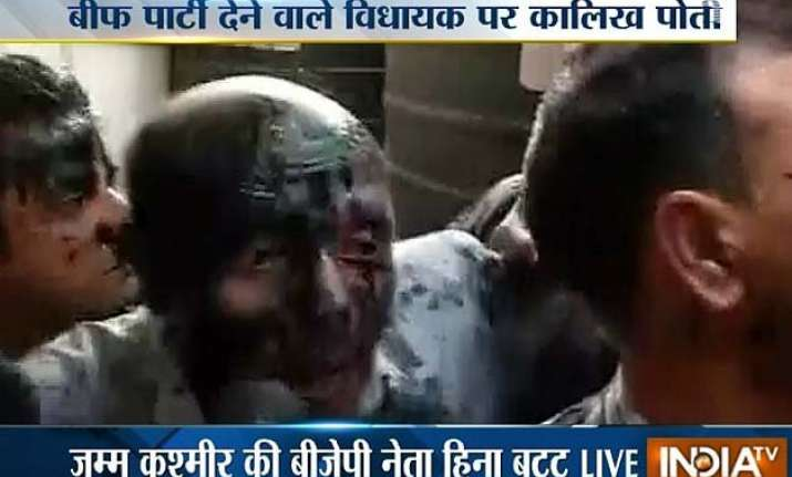 ink thrown at j k mla rashid who had hosted beef party in