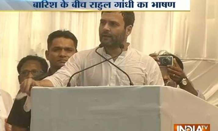 rahul gandhi targets pm modi in a rain hit rally