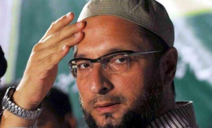 congress leader attack owaisi surrenders before police