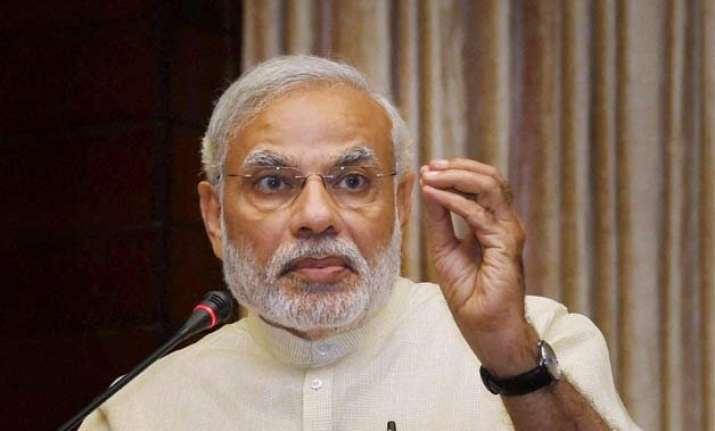 on hiroshima bombing day pm modi pitches for violence free
