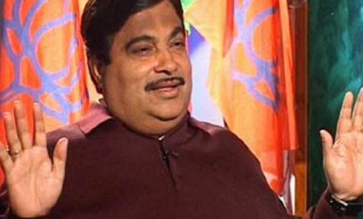 congress alleges gadkari of holding benami flat in adarsh