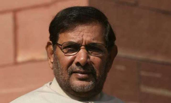 jd u to back rld candidates in up by polls sharad yadav