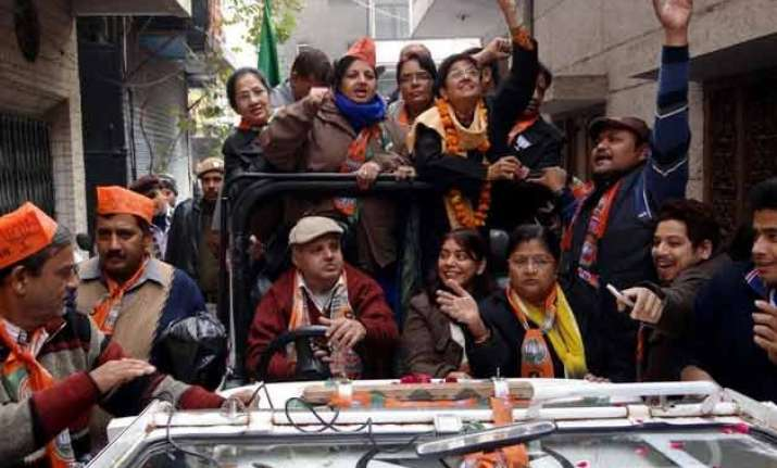 delhi polls kiran bedi campaigns in south delhi tweets