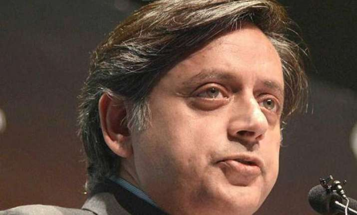 touched by pm modi s graciousness says shashi tharoor on