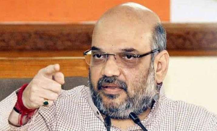 jnu row amit shah slams cong says rahul supporting anti