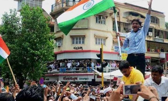centre rushes paramilitary troops to gujarat rajnath singh