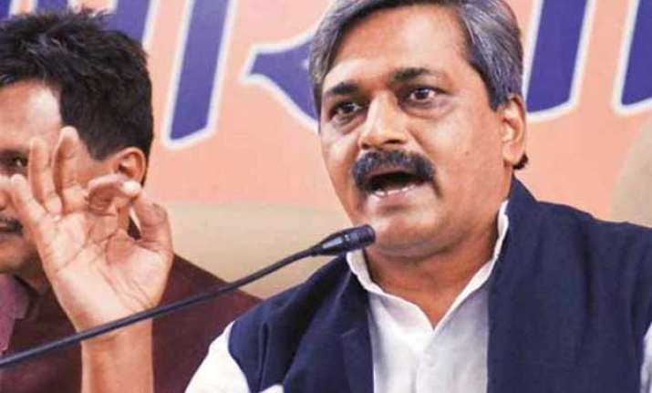 bjp lashes out at aap for misleading public about raids