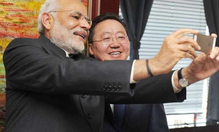 pm modi unchecked selfies an obsession or a way to connect