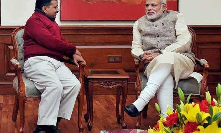 modi s 1 year vs kejriwal s 100 days war erupts on twitter