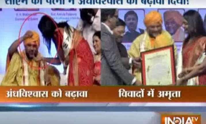 video godman presents necklace to maha cm devendra fadnavis
