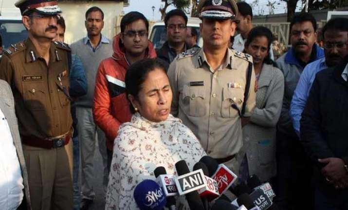 mamata banerjee threatens action against any forcible