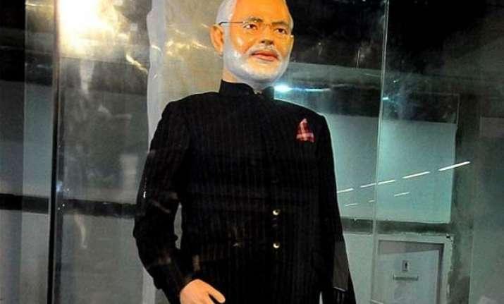 shiv sena defends modi on auction of monogrammed suit