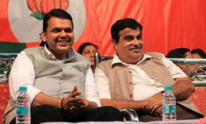 i am happy in delhi says gadkari after fadnavis meets him
