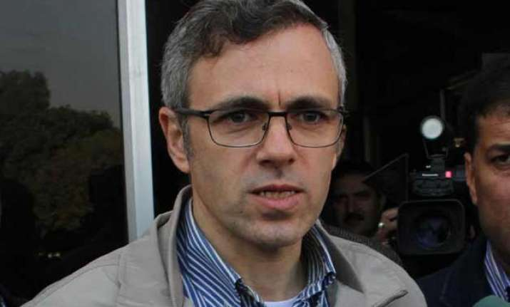 omar accuses pdp patron of being sell out to bjp