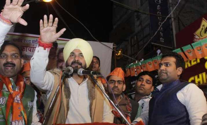 delhi polls on campaign trail for bjp sidhu pushes buy one