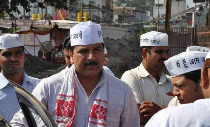 bhushan yadav worked for maligning aap s image sanjay singh