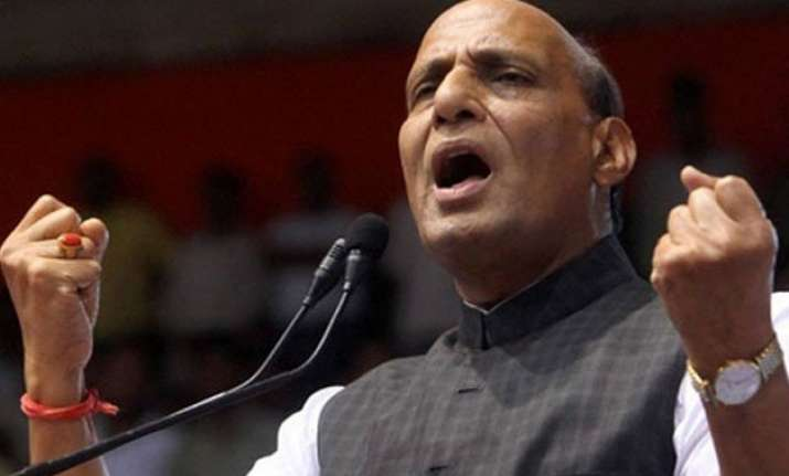 pakistan trying to push terrorists into j k rajnath singh
