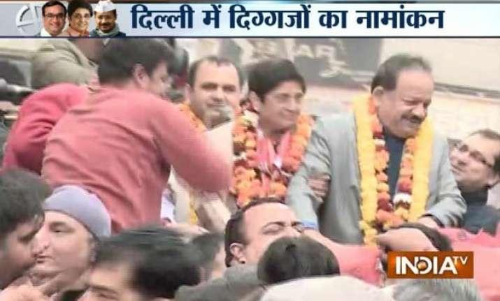 delhi polls kiran bedi arvind kejriwal file nominations