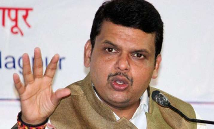 fadnavis defends bjp minister girish mahajan who carried