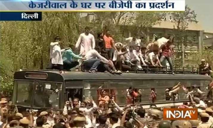 delhi road rage bjp activists protest outside kejriwal s