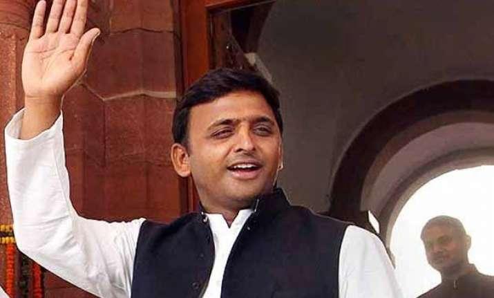 cm akhilesh yadav seeks to silence critics on completion of