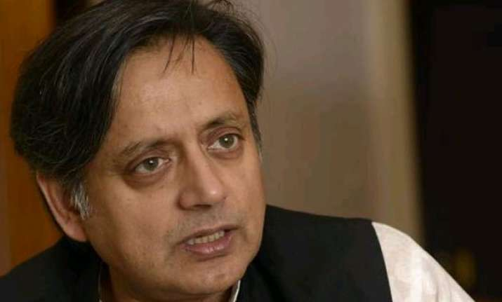 tharoor accuses modi of silence on conversion other issues