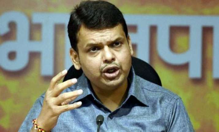 after gadkari cm fadnavis accused of riding without helmet